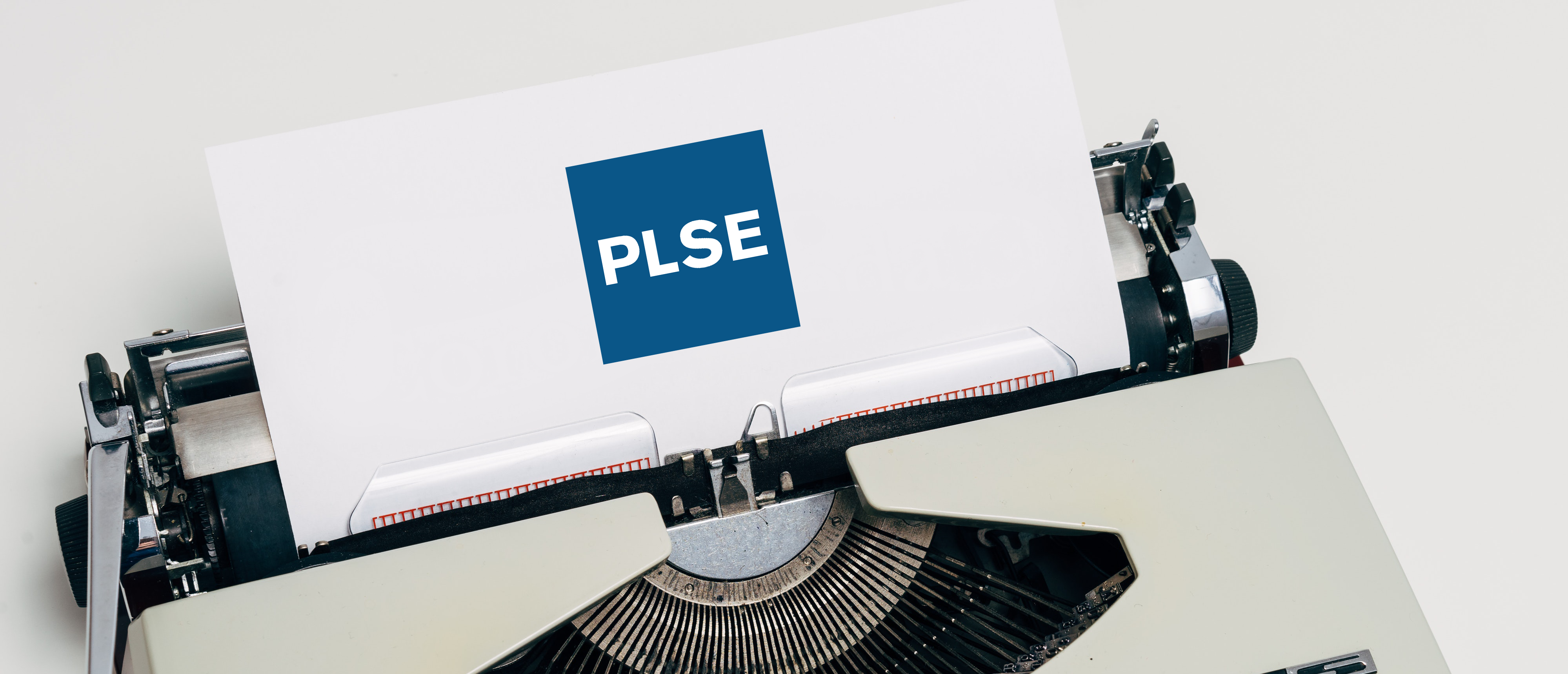 Typewriter with PLSE logo